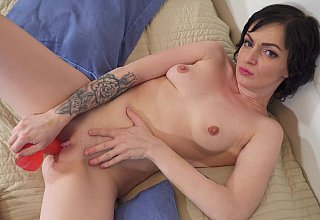 Brunette gapes her pussy with a red toy